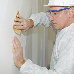 Man removing textured paint