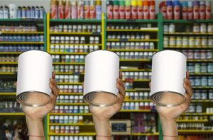 hands holding up three different paint cans in front of a shelve in a paint store